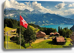 Постер Швейцария. View of Interlaken with Swiss flag