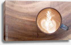 Постер Top view of hot coffee latte art on wooden table