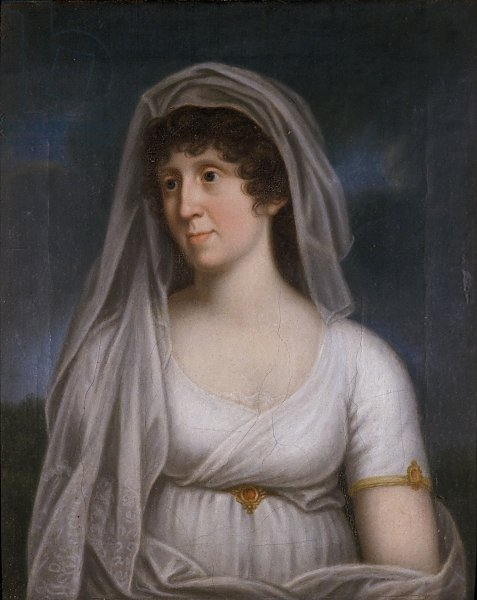 Women in a white dress with a veil