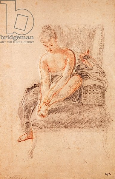 Semi-nude woman seated on a chaise longue, holding her foot